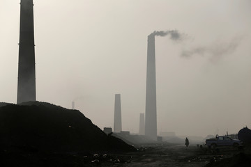 A general view of brick factories as smoke rises from the stacks in the town of Nahrawan in Baghdad