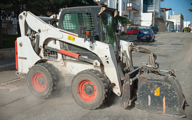 Milling of asphalt for road reconstruction accessory for skid steer