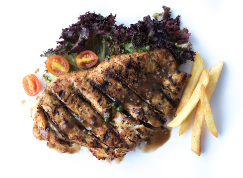 Chicken steak with french fries isolated on white background