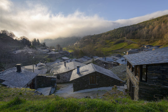 Slate roofs and stone walls in a restored village in Courel