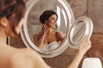 Beautiful bride preparing herself