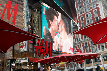 Two men kissing on an advertising video display coinciding with the 50th anniversary of the1969 Stonewall uprising, considered the birth of the lesbian, gay, bisexual and transgender (LGBT) movement is seen on display at the H&M retail stores at Times Squa