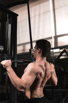 Young fitness man training in gym