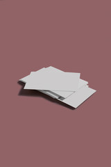 From above white business card stack template placed on brown background