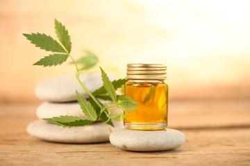 cbd oil bottle and hemp leaf . medical cannabis