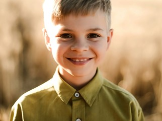Portrait of a little  boy playing on a wheat field in the summertime