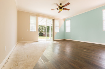 Empty Room with Cross Section Showing Before and After With New Wood Floor and Paint