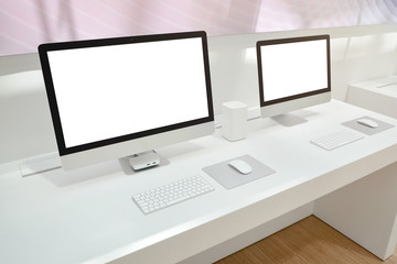 Wall Mural - Two computers with isolated screens for mockup on office desk.