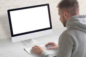 Wall Mural - Man work on computer concept. Isolated, white, blank screen on computer display for mockup.