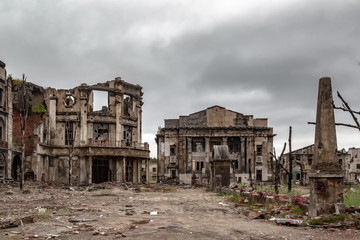 Obraz Destroyed house. Remains of old houses. Ruin. Apocalypse. Abandoned city. Ghost town. - fototapety do salonu