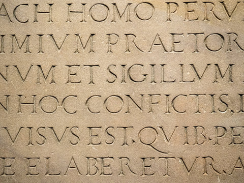 Old Latin text engraved on stone latin characters words