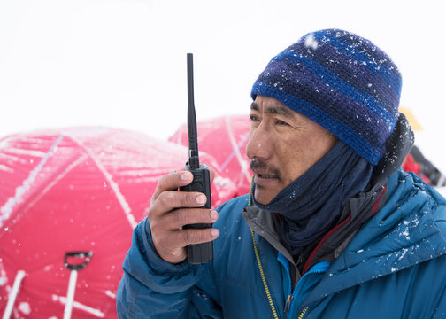 Nepal, Solo Khumbu, Everest, Ghurka using radio in Camp