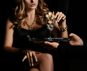 Portrait of sexy beautiful woman decide to choose auto perfume from glass of many bottles on dark