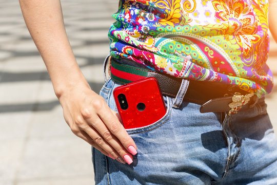 phone in jeans pocket / bright day photo