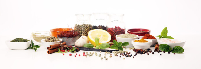 Fototapeta Spices and herbs on table. Food and cuisine ingredients with basil obraz
