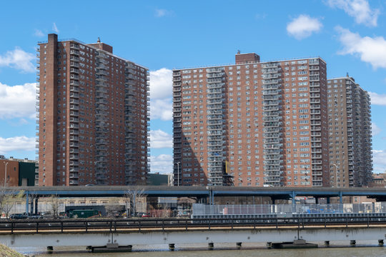 NYC housing projects on 145th Street and Malcolm X Boulevard in Harlem, seen from the Bronx, New York City, USA