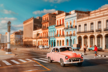 Old american car and  colorful buildings in Havana