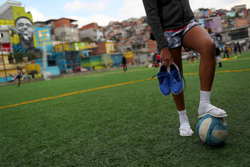 Gabriella da Silva de Oliveira, 21, stands as she waits for a training session of soccer to begin in Jardim Peri Alto slum, where Brazil's soccer player Gabriel Jesus lived in during his childhood, in Sao Paulo