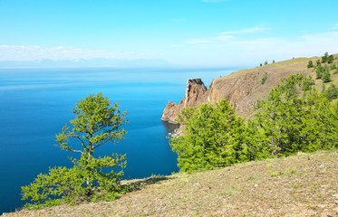 Baikal Lake in the summer. The famous Cape Khoboy is the northern tip of Olkhon Island, an attraction for all tourists visiting the island.  Natural background. Beautiful lake landscape