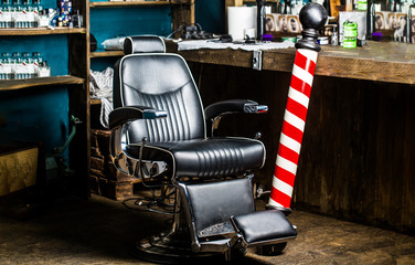 Barber shop chair. Barbershop armchair, barber shop for men. Barber shop pole. Logo of the barbershop, symbol. Stylish vintage barber chair. Hairstylist in barbershop interior