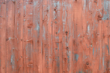 Natural wooden background. Surface of wooden texture for design and decoration. Shabby vertical boards with peeling paint. Brown with a pink shade. Copy space.