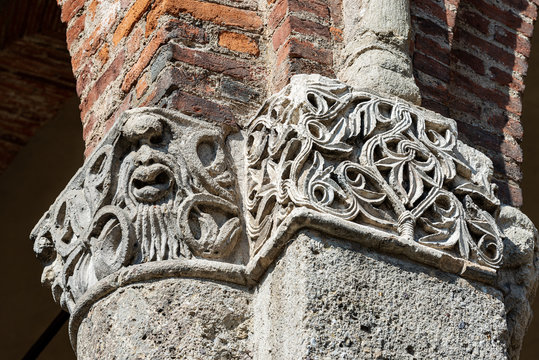 Detail of a capital with column. Ancient basilica of Saint Ambrogio, 379-1099, in Lombard Romanesque style. Milan, Lombardy, Italy, Europe