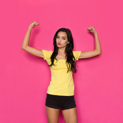 Strong Beautiful Woman Is Flexing Muscles