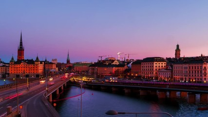 Wall Mural - Stockholm, Sweden. Time-lapse of Gamla Stan in Stockholm, Sweden with landmarks like Riddarholm Church during the sunrise. View of old buildings and car traffic at the bridge, panning video