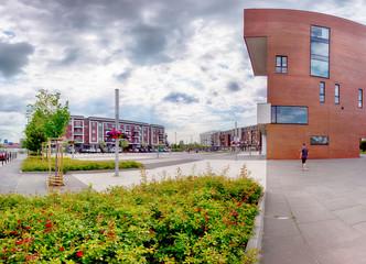 Obraz WROCLAW, POLAND - JUNE 01, 2019: Siechnice City Center (near Wroclaw, Poland) with modern City Hall. Architects of this urban project: Mackow Pracownia Projektowa. - fototapety do salonu