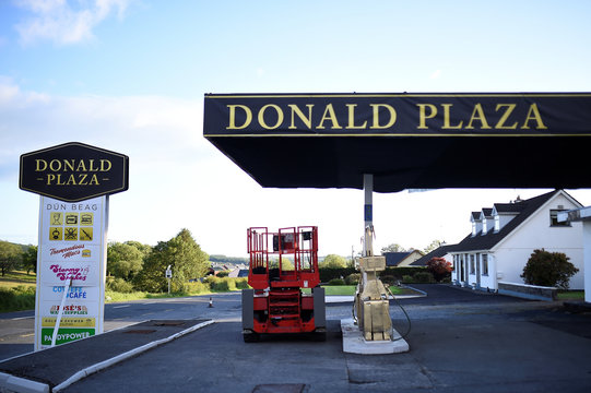 A disused fuel station is rebranded as 'Donald Plaza' with fuel pumps painted in gold during the visit of U.S. President Donald Trump in the County Clare village of Doonbeg, Ireland