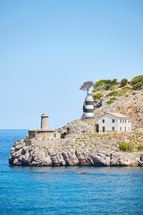 Wall Mural - Lighthouse in Port de Soller, picturesque little village located at the foot of the Serra de Tramuntana, Majorca, Spain.