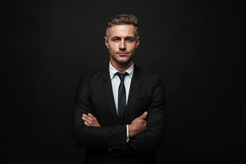 Handsome confident businessman wearing suit Fotobehang