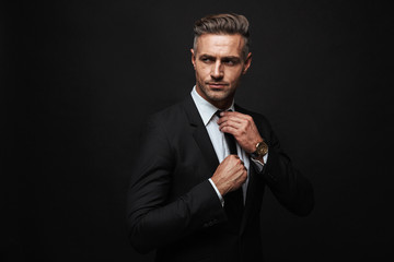 Handsome confident businessman wearing suit