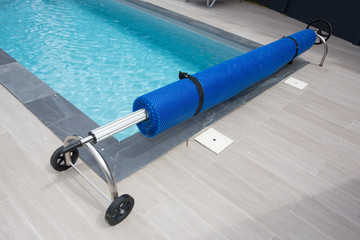 Swimming pool steel blue bubble solar winder detail for protection and heat the water