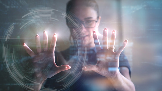 Portrait of an young man is using the futuristic latest innovation technology with augmented reality hologram.