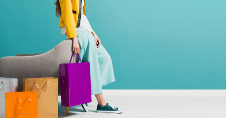 Wall Mural - Stylish woman carrying a lot of shopping bags