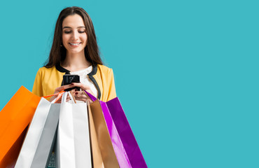 Wall Mural - Happy woman using shopping apps