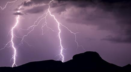 A panorama photo of lightning striking the slopes of Woolsey Peak during the 2012 Arizona Monsoon season, Arizona, United States of America, North America