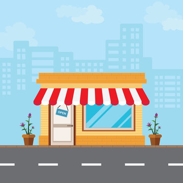 Shop in the front style is located along the road amidst the vast capital city.