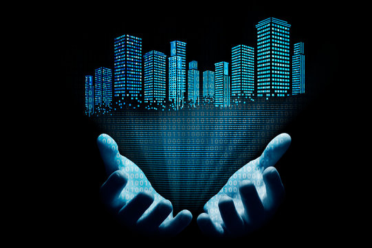 The hologram of a city with a binary code comes from the hands