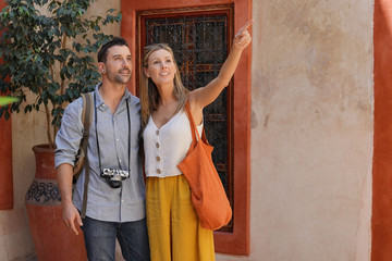 Stylish couple exploring traditional Moroccan riad