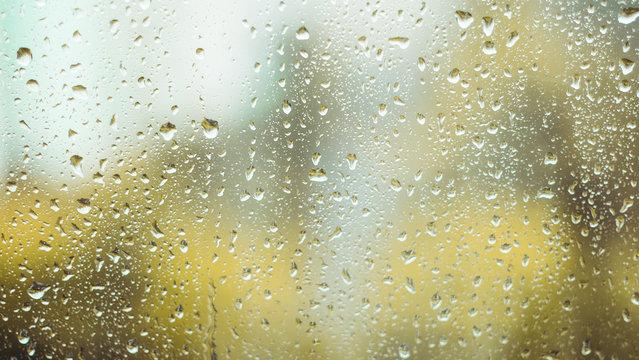 rain drops on the window. rainy window in autumn. abstract view.