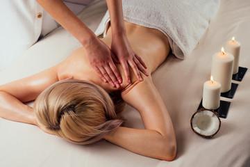 Ayurvedic relaxing.health beauty happy blonde woman in spa salon getting massage .Beautiful girl...