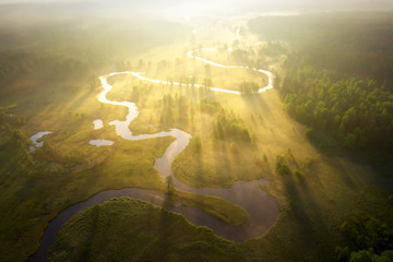 Misty morning river in sunlight. River landscape aerial view. Riverside view from above. Summer nature in sun rays. Drone view on  sunny nature. Scenery river top view. Fototapete