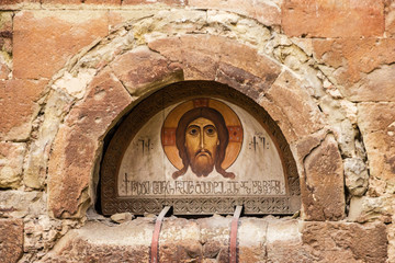 Tbilisi, Georgia: Icon of Christ on the building of ancient Georgian church.