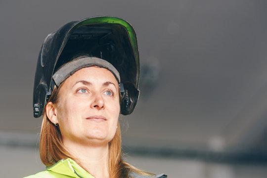 woman in welding helmet.