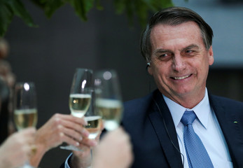 Brazil's President Jair Bolsonaro takes part in a toast at the Casa Rosada government house in Buenos Aires