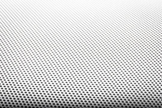 Abstract background is a metal grid, white cover round speaker