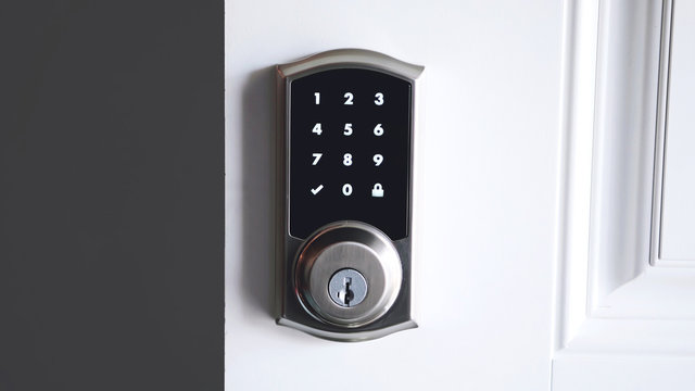 Digital smart door lock security system with the password, close up on numbers on the screen.