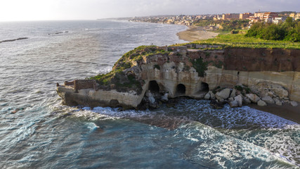 Aerial view of the free beach of the Nerone caves next to the Imperial Villa of Anzio in Italy. Here are the ruins of the emperor's villa of ancient Rome.